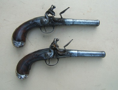 A VERY GOOD & EARLY PAIR OF SILVER MOUNTED LION�S MASK-BUTT QUEEN ANN PISTOLS, by DAVID WYNN, ca. 1720 view 1