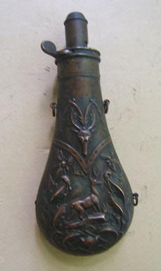 A GOOD+ UNTOUCHED MID 19th CENTURY AMERICAN EMBOSSED BRASS POWDER FLASK, ca. 1860s view 1