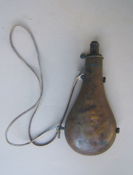 A FINE QUALITY MID 19TH CENURY ENGLISH PLAIN COPPER POWDER FLASK, ca. 1850 view 1