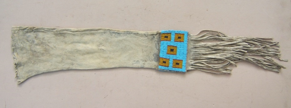 A FINE TRADE-BEAD DECORATED MID-19TH CENTURY AMERICAN PLAINS INDIAN (SIOUX) BUFFALO HIDE PIPE-BAG, ca. 1870 view1